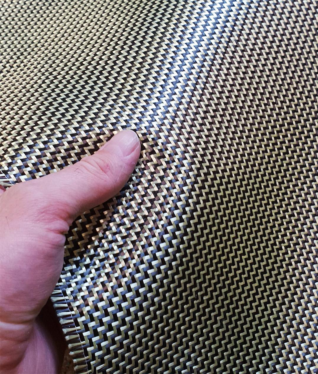 Manufacturing kevlar-carbon fiber hybrid parts
